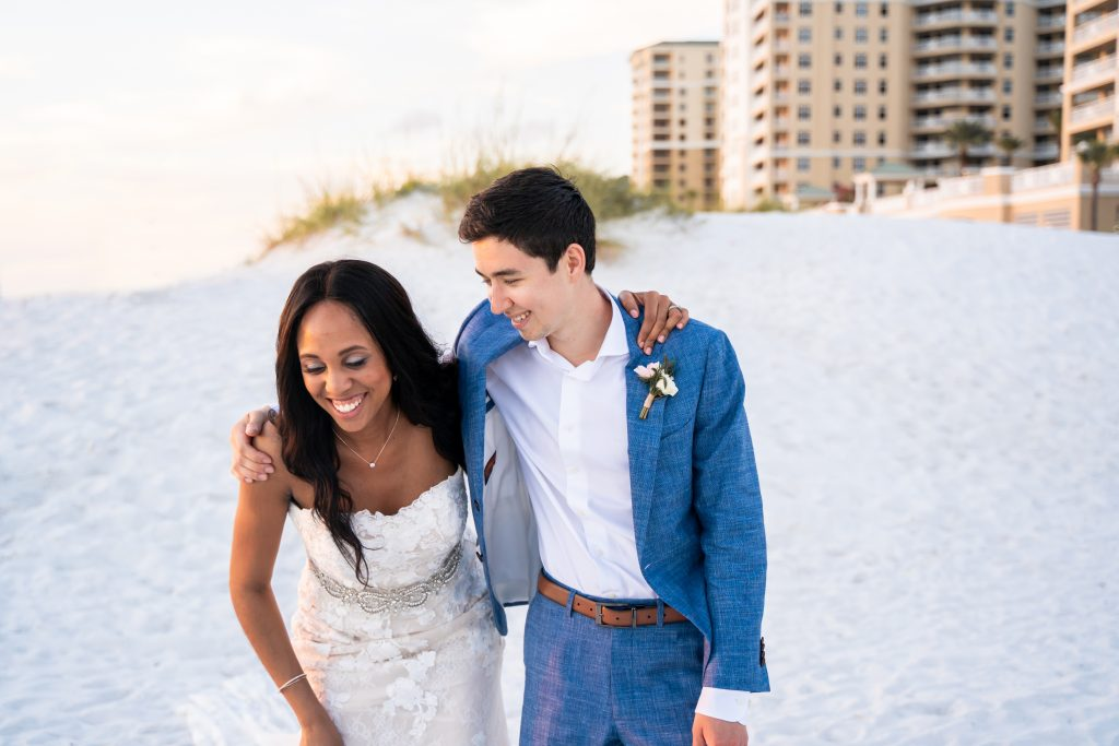 hilton clearwater beach flower florals arch wedding destination photographer pronovias wedding dress wedding st petersburg wedding dress cape  sunset gulf of mexico  First look reception tables center pieces